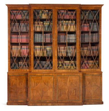 View 1. Thumbnail of Lot 59. A Regency brass inlaid and ebony strung mahogany breakfront library bookcase, circa 1815.