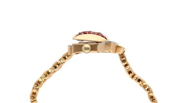 View 5. Thumbnail of Lot 163. A pink gold diamond and ruby-set concealed bracelet watch, Circa 1940.