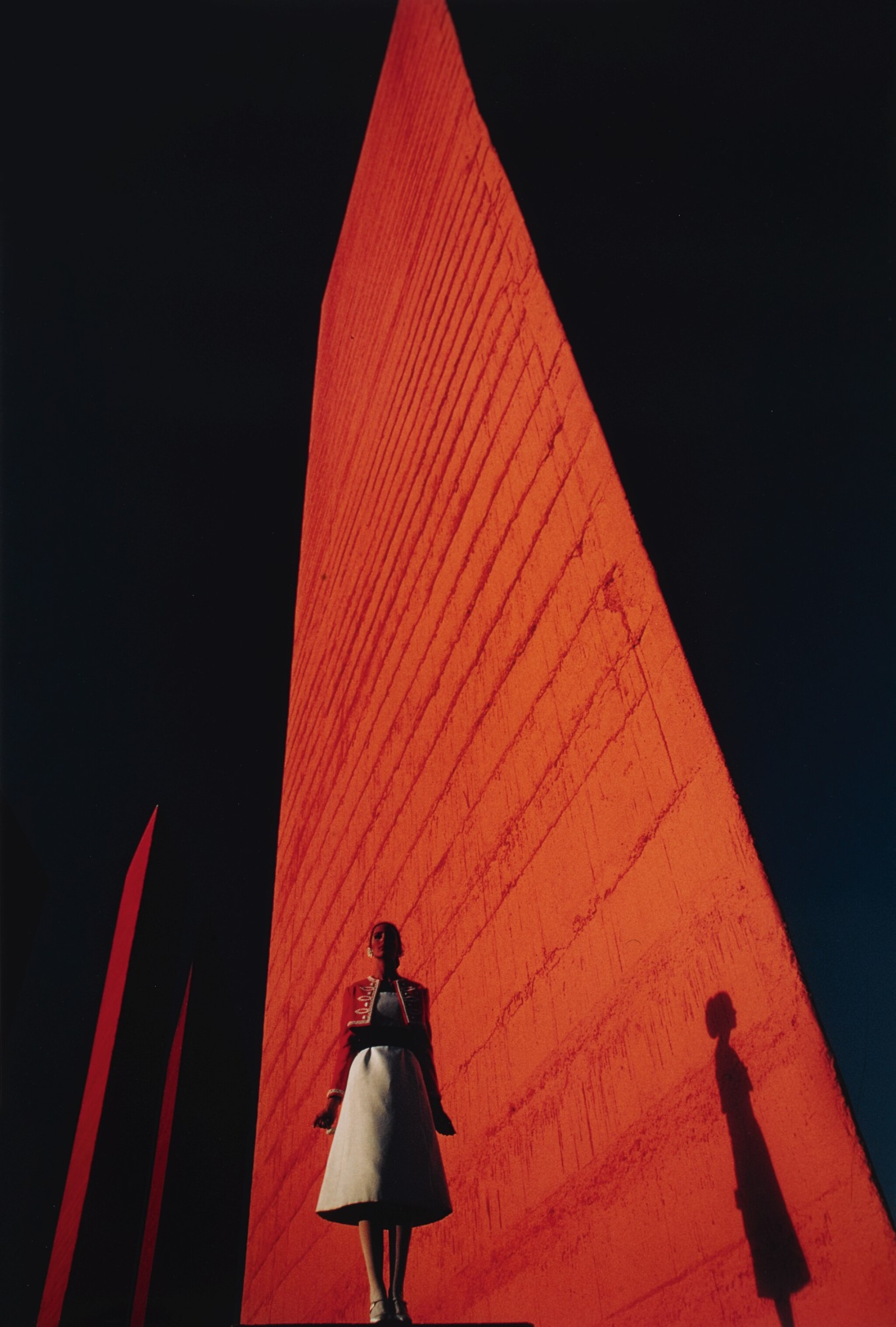 View full screen - View 1 of Lot 66. Cynthia Korman in front of a Luis Barragán Building .