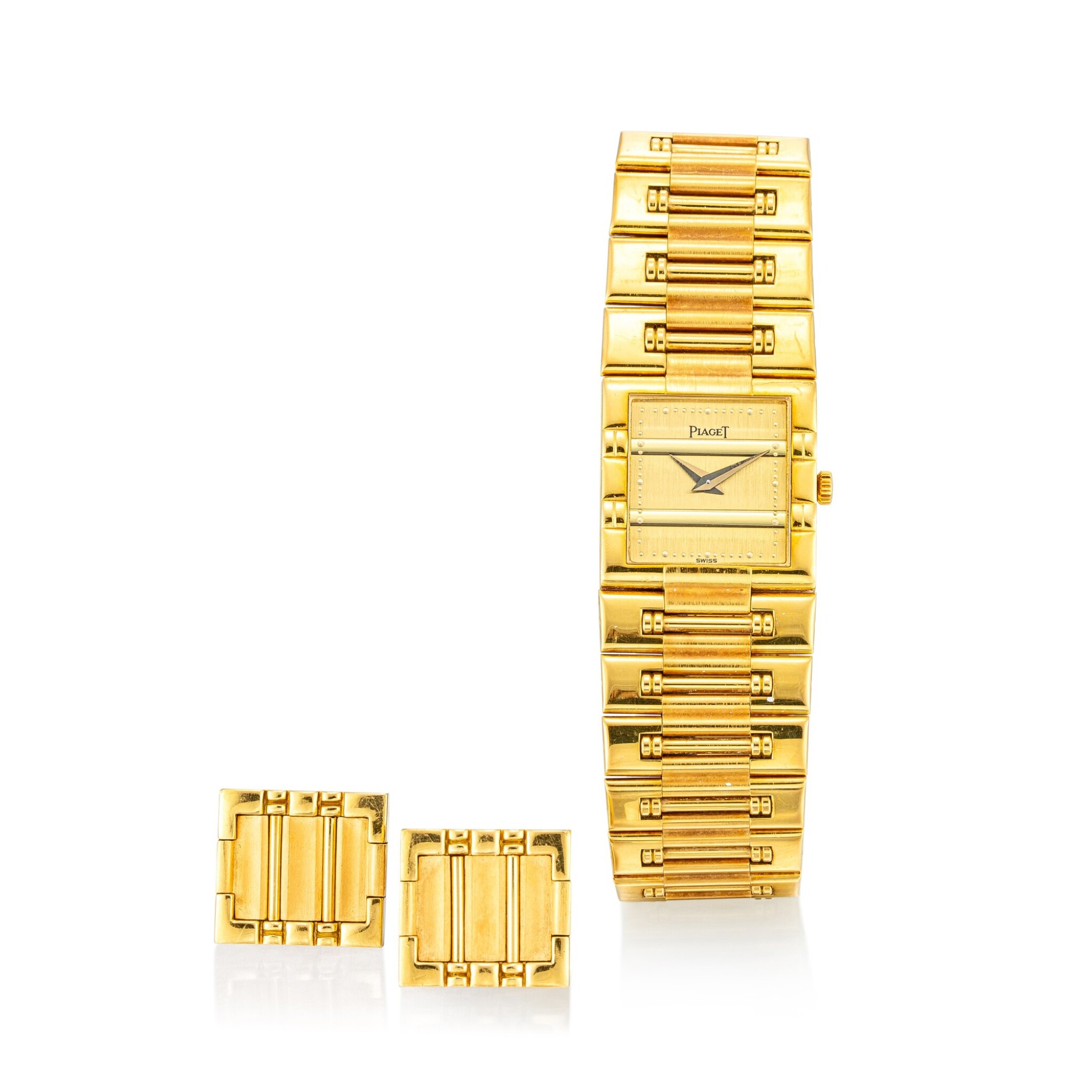 View full screen - View 1 of Lot 1105. PIAGET   DANCER, REFERENCE 81317 K81 A YELLOW GOLD BRACELET WATCH WITH A PAIR OF ASSOCIATED CUFFLINKS, CIRCA 1990.