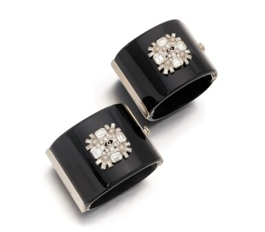 View 1. Thumbnail of Lot 172. Pair of black resin and rhinestone wide cuffs.