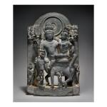 A BLACK STONE FIGURE OF UMA-MAHESHVARA,  WESTERN INDIA, HARYANA, 12TH CENTURY