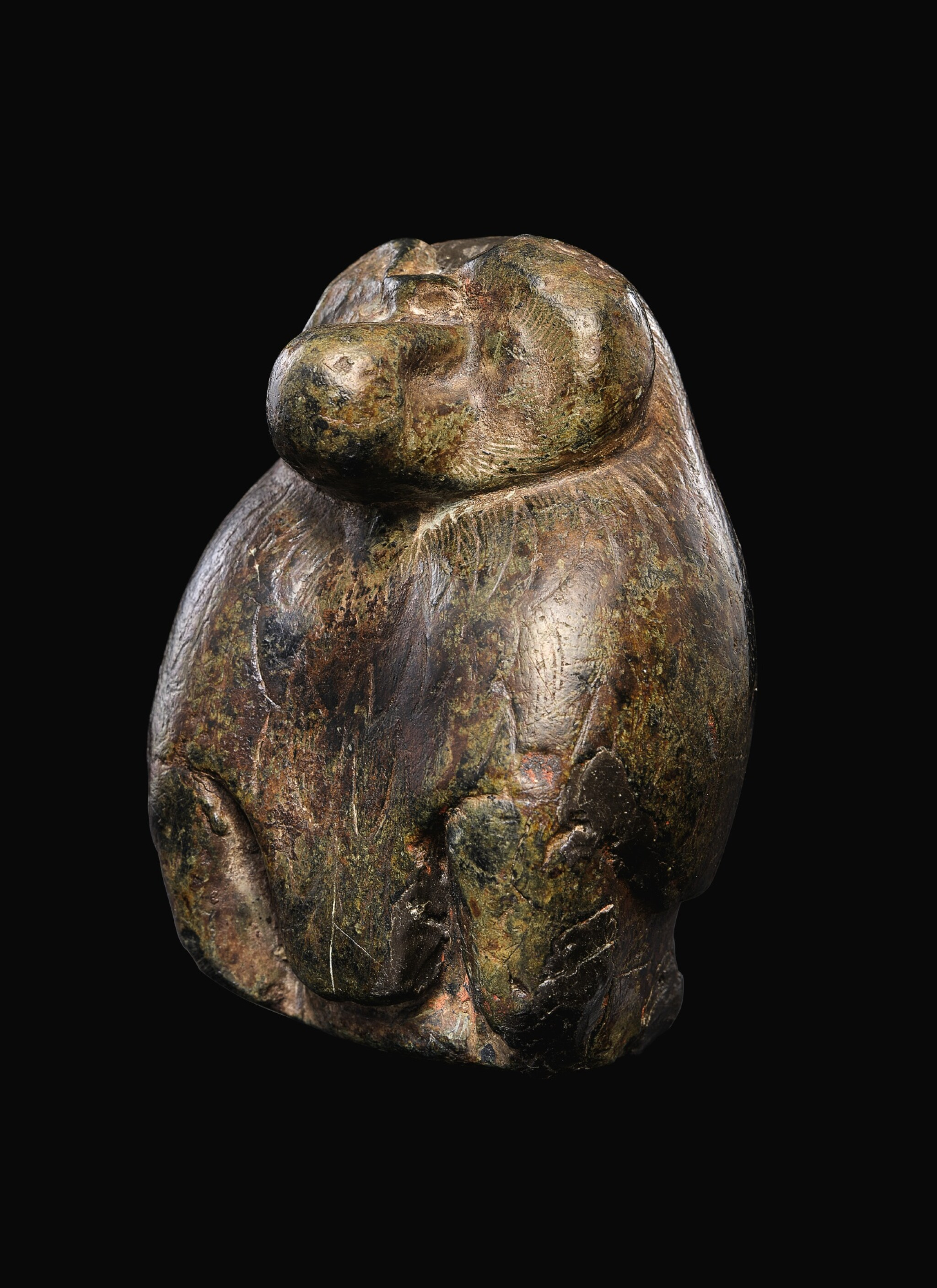 View full screen - View 1 of Lot 56. AN EGYPTIAN SERPENTINE FIGURE OF A BABOON, 26TH/30TH DYNASTY, 664-342 B.C..