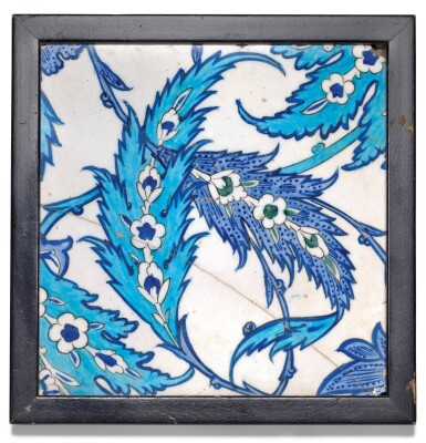 View 1. Thumbnail of Lot 38. AN IZNIK LIGHT AND COBALT BLUE POTTERY TILE WITH SAZ LEAVES, TURKEY, CIRCA 1545-55.