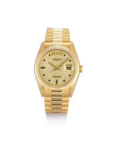 "View 1. Thumbnail of Lot 2109. ROLEX | DAY-DATE, REFERENCE 18238, A YELLOW GOLD, DIAMOND AND SAPPHIRE-SET WRISTWATCH WITH DAY, DATE AND BRACELET, CIRCA 1991 | 勞力士 | ""Day-Date 型號18238 黃金鑲鑽石及藍寶石鏈帶腕錶,備日期及星期顯示,機芯編號X629862,約1991年製""."