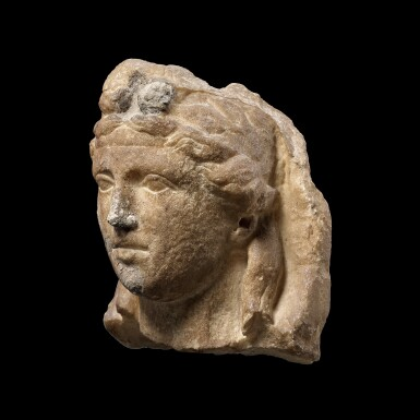 View 2. Thumbnail of Lot 64. A Roman Marble Herm Head of the Young Dionysos, circa 2nd Century A.D..