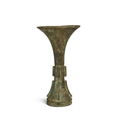 View 3. Thumbnail of Lot 2. An archaic bronze ritual wine vessel (Gu), Late Shang dynasty | 商末 青銅饕餮紋觚.