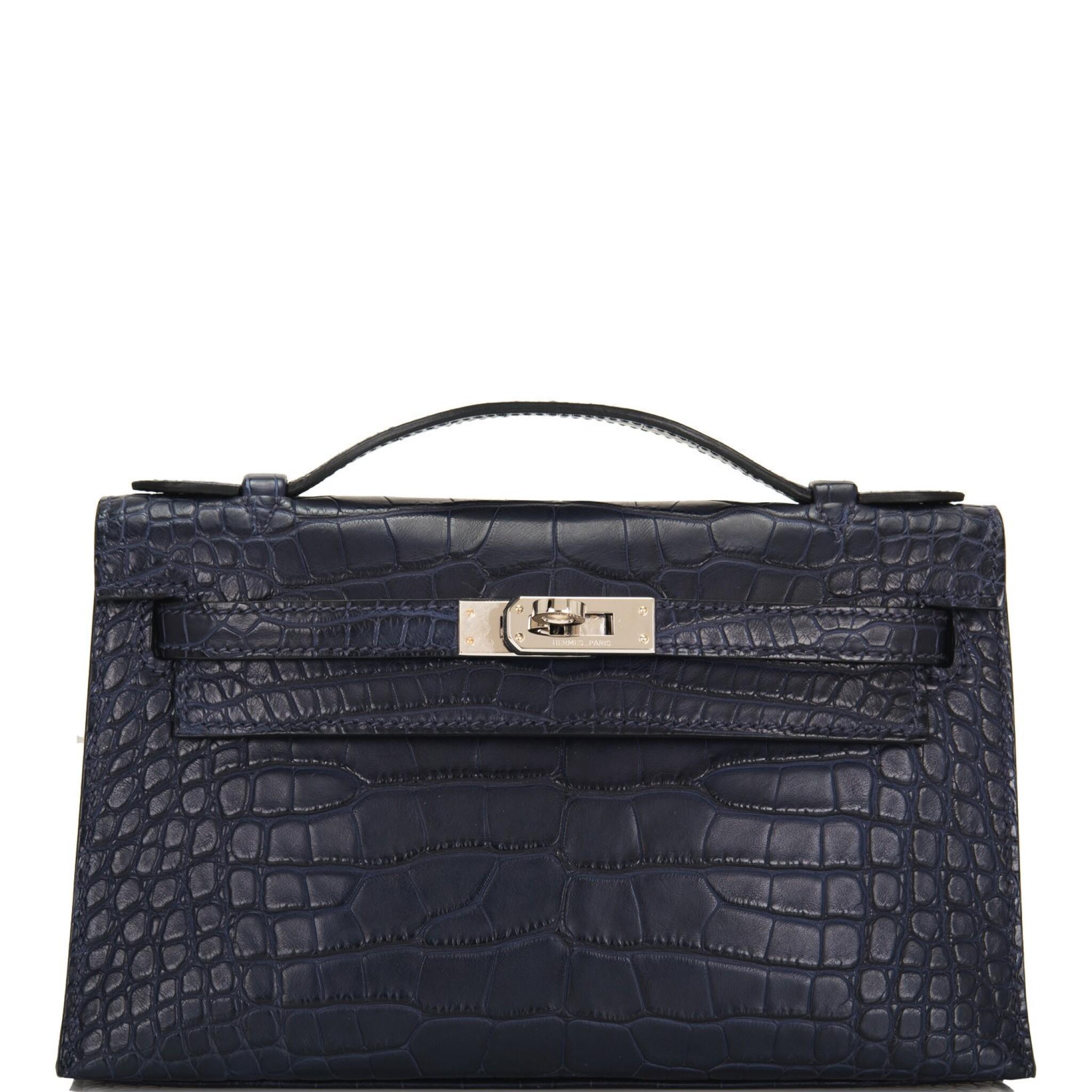 View 1 of Lot 44. Hermès Mini Kelly Pochette of Bleu Indigo Matte Mississippiensis Alligator with Palladium Hardware.