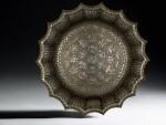 A rare and important Khurasan silver-inlaid brass basin, probably Herat, circa 1200