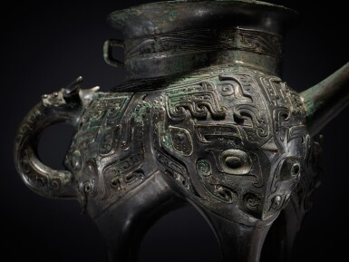 View 6. Thumbnail of Lot 12. An exceptionally rare archaic bronze ritual pouring vessel (He), Eastern Zhou dynasty, Spring and Autumn period | 東周 春秋 青銅獸面紋龍流盉.