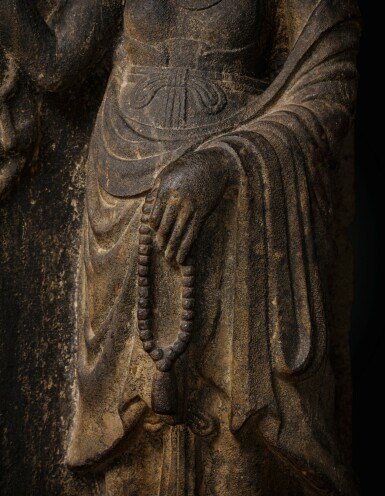 View 5. Thumbnail of Lot 51. A rare limestone carving of a Buddhist acolyte, possibly Jianglong Luohan Northern Song dynasty, 10th-11th century   北宋十至十一世紀 石灰石浮雕或為降龍羅漢像.