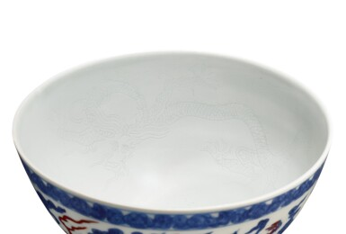 View 2. Thumbnail of Lot 3611. An extremely rare doucai and anhua-decorated 'dragon' bowl Mark and period of Zhengde | 明正德 鬪彩內暗花外雲龍紋盌 《正德年製》款.