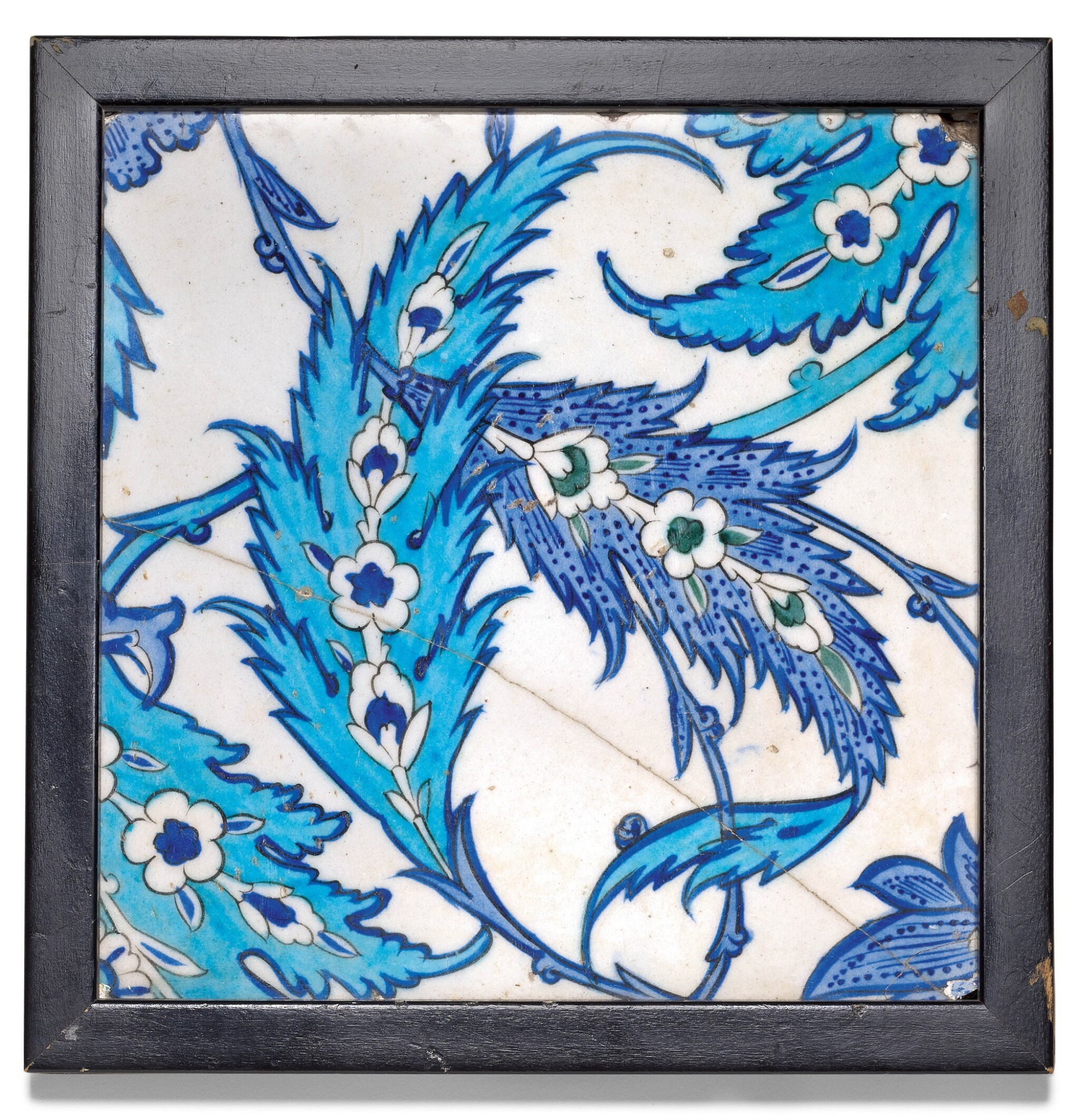 View full screen - View 1 of Lot 38. AN IZNIK LIGHT AND COBALT BLUE POTTERY TILE WITH SAZ LEAVES, TURKEY, CIRCA 1545-55.
