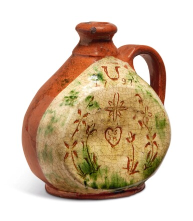View 3. Thumbnail of Lot 303. Rare Glazed Sgraffito and Slip-Decorated Redware Jug, Pennsylvania, dated 1797.