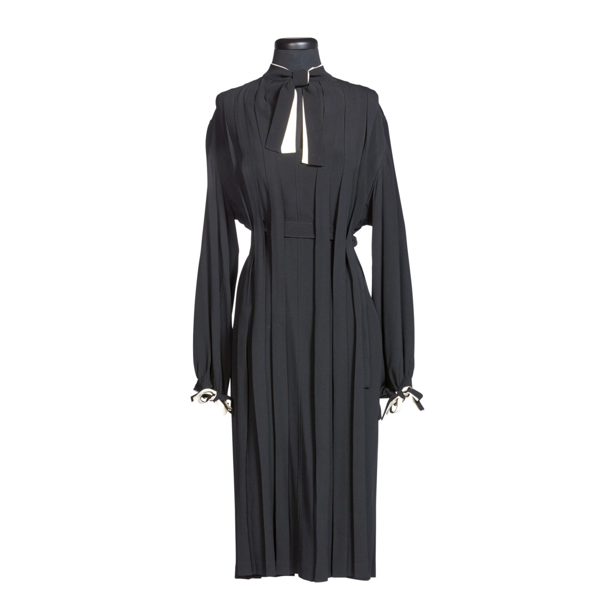 View 1 of Lot 56. GEORGIA O'KEEFFE | CUSTOM BLACK AND WHITE PLEATED DRESS.