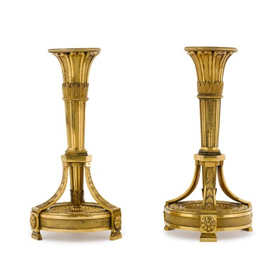 View 1. Thumbnail of Lot 189. A pair of Louis XVI gilt-bronze candlesticks, the design attributed to Jean-Louis Prieur, late 18th century.