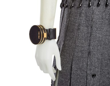 View 6. Thumbnail of Lot 43. PRADA   EMBROIDERED WOOL PLEATED SKIRT, BEADED FRINGE TOP AND VANITY BRACELET, WORN BY FIA LJUNGSTROM.