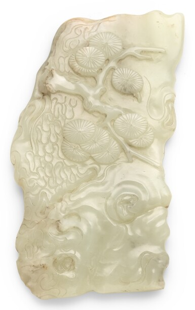 A PALE CELADON JADE PAPERWEIGHT QING DYNASTY, 19TH CENTURY | 清十九世紀 青白玉松樹紋樁式鎮紙