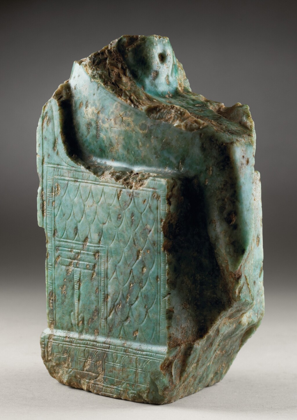 A FRAGMENTARY EGYPTIAN MAGNESITE MARBLE FIGURE OF A ISIS, 26TH/30TH DYNASTY, 664-342 B.C.