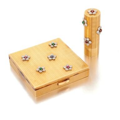 View 1. Thumbnail of Lot 53. Emerald, ruby, sapphire and diamond powder box and lipstick holder (Portacipria e porta rossetto con smeraldi, rubini, zaffiri e diamanti).