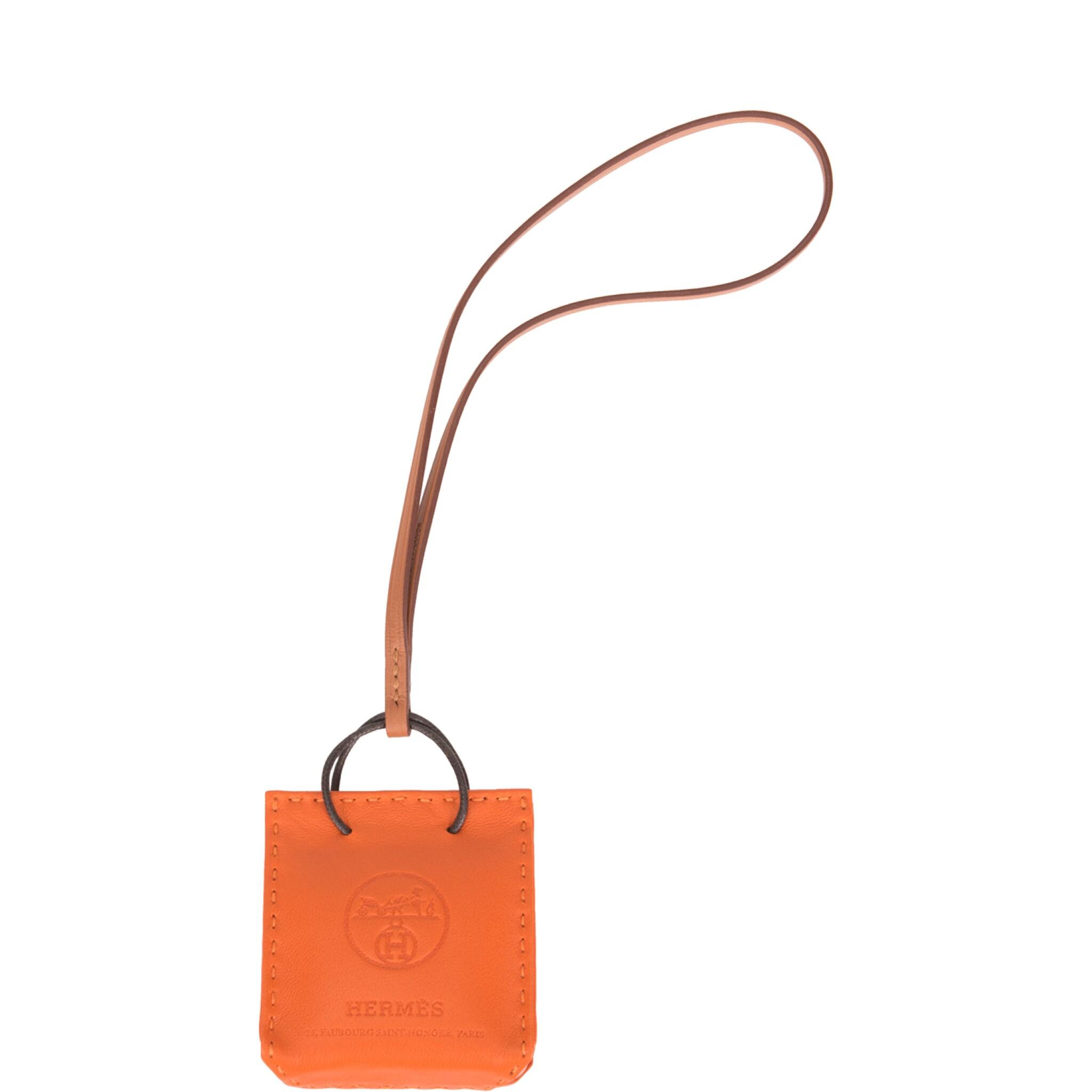 View full screen - View 1 of Lot 100. Hermès Orange Bag Charm.