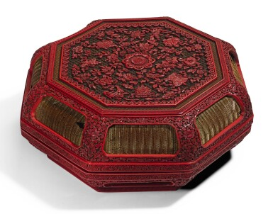 A LARGE CARVED POLYCHROME LACQUER 'BAJIXIANG' BOX AND COVER   QING DYNASTY, QIANLONG PERIOD | 清乾隆 剔彩八吉祥紋八方蓋盒