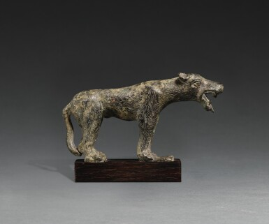 A ROMAN BRONZE FIGURE OF A WOLF, CIRCA 2ND CENTURY A.D.