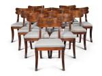 A set of twelve Regency mahogany and ebony 'Klismos' dining chairs, circa 1815, after a design by Thomas Hope
