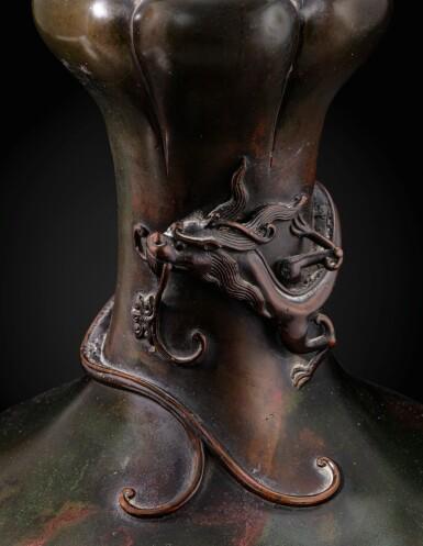 View 3. Thumbnail of Lot 151. A rare large garlic-mouth bronze 'dragon' vase Qing dynasty, 17th century | 清十七世紀 銅盤龍蒜頭瓶.