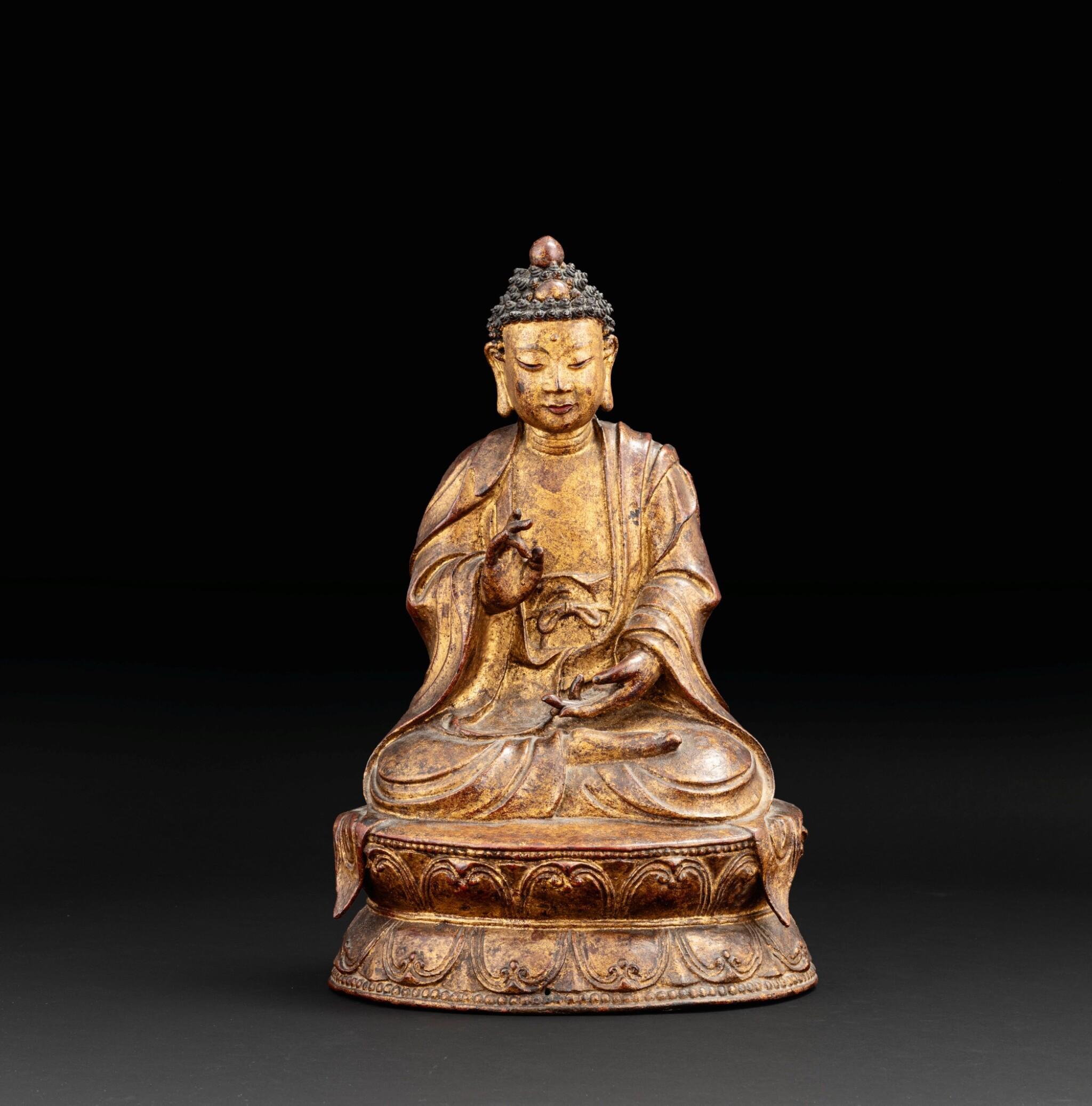 View 1 of Lot 51. Grande Statue de Bouddha en bronze laqué doré Probablement fin de la dynastie Ming, XVIE-XVIIE siècle | 或為明十六至十七世紀 漆金佛坐像 | A large lacquer-gilt bronze figure of Buddha, probably Ming Dynasty, 16th-17th century.