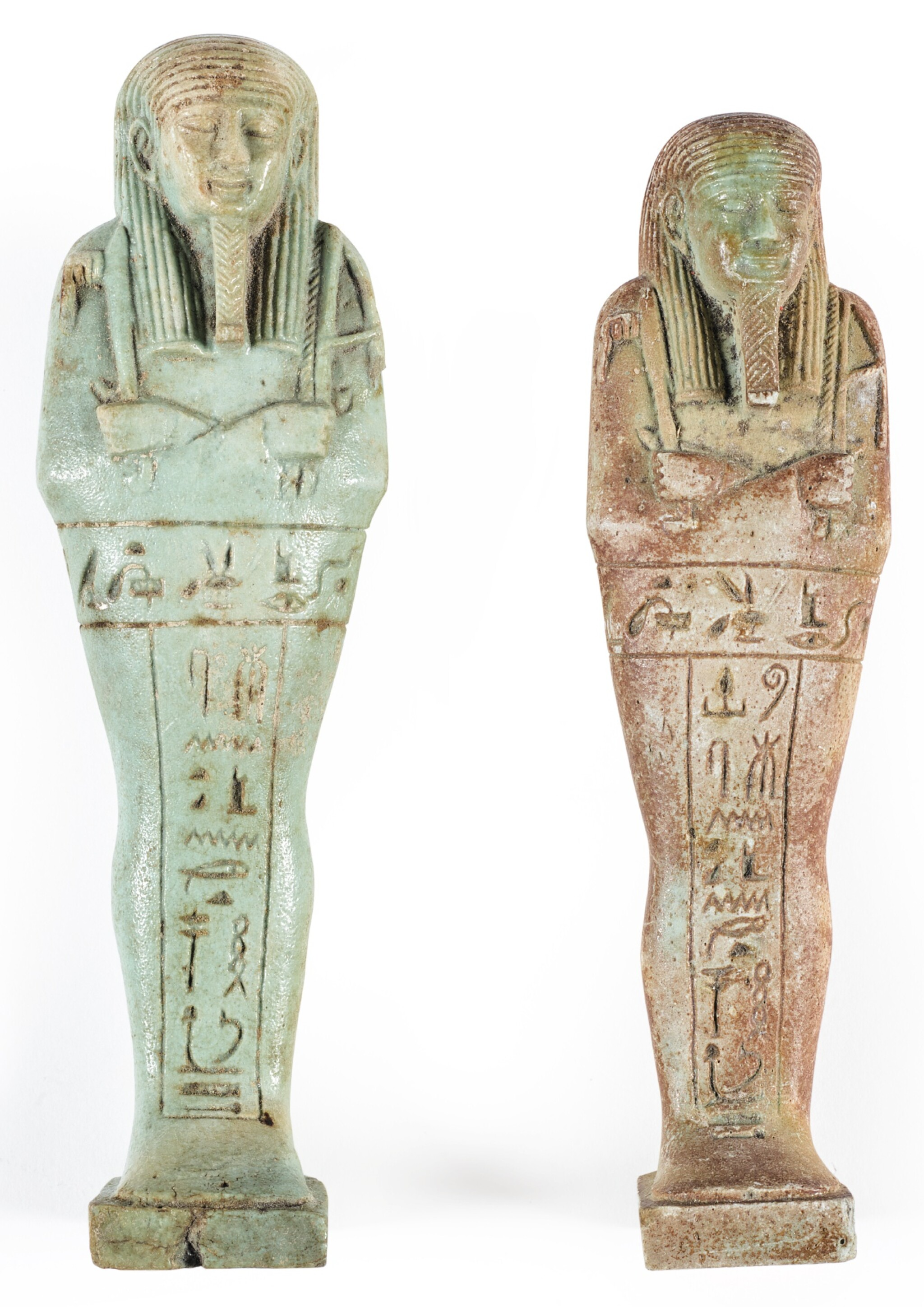 View full screen - View 1 of Lot 179. TWO EGYPTIAN GREEN-GLAZED USHABTIS, 26TH DYNASTY, CIRCA 664-525 B.C..