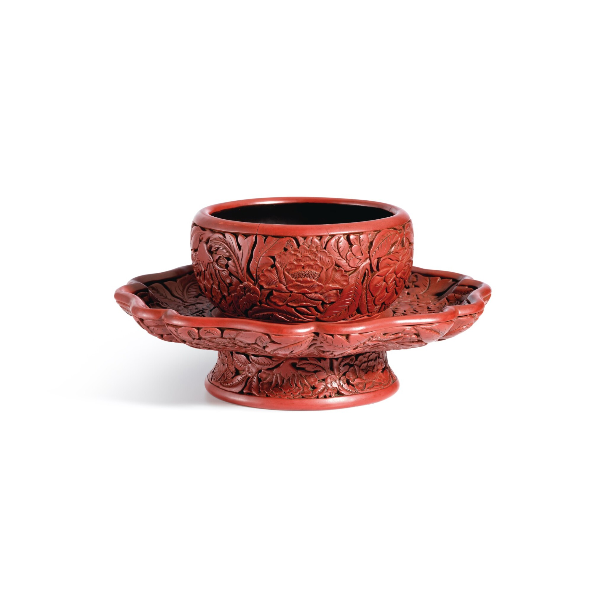 View full screen - View 1 of Lot 3662. An exceptional and important carved cinnabar lacquer bowl stand, Ming dynasty, Hongwu period, Yongle and Xuande marks   明洪武 剔紅花卉紋盞托 《大明永樂年製》、《大明宣德年製》款.