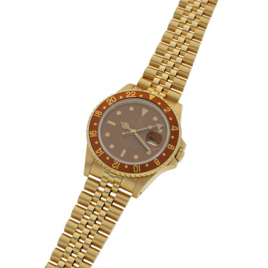 View 2. Thumbnail of Lot 161. ROLEX   GMT-MASTER II REF 16718, A YELLOW GOLD AUTOMATIC DUAL TIME WRISTWATCH WITH DATE AND BRACELET CIRCA 1990.