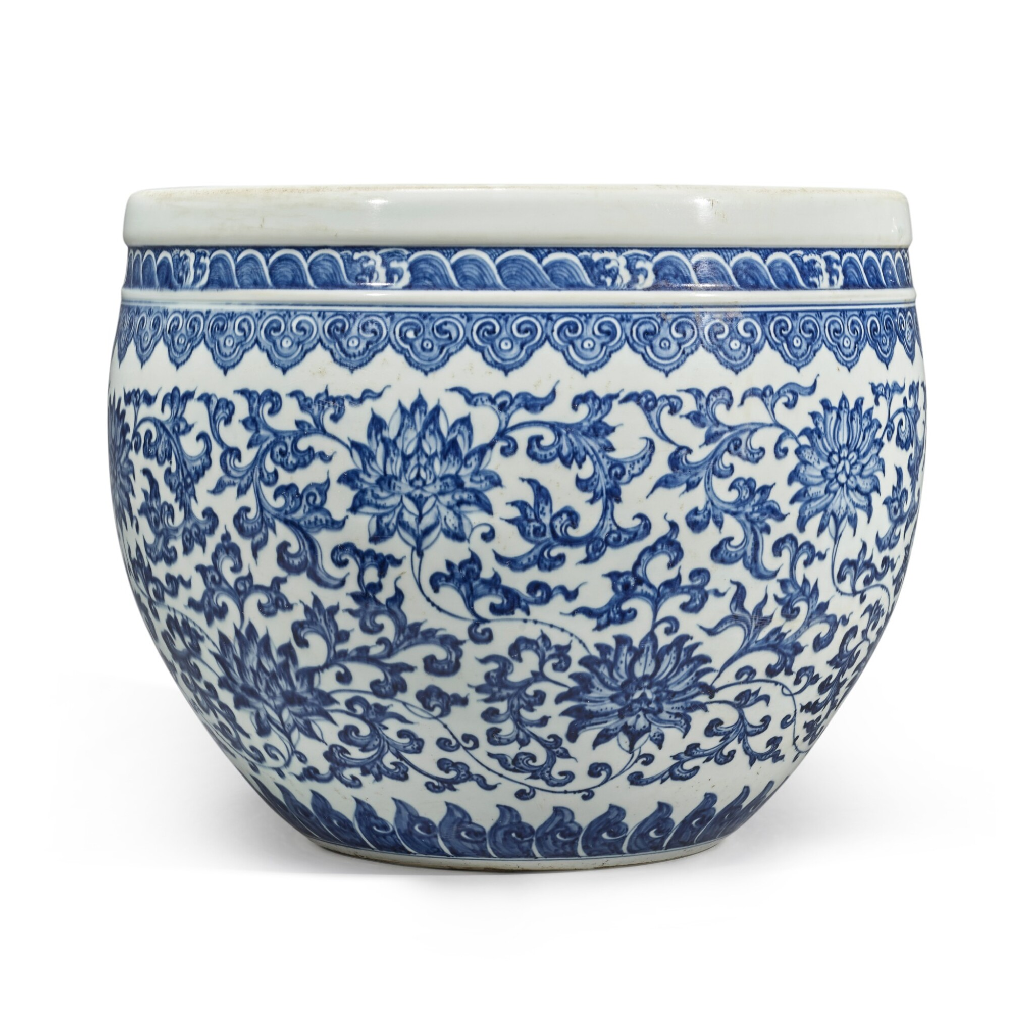 View full screen - View 1 of Lot 74. A blue and white 'floral' fishbowl, Qing dynasty, 18th century | 清十八世紀 青花纏枝蓮紋缸.