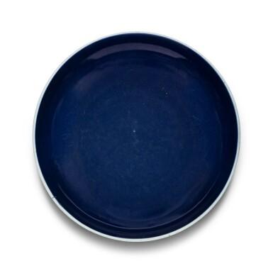 View 1. Thumbnail of Lot 17. Grand plat en porcelaine monochrome bleu Dynastie Qing, XVIIIE siècle   清十八世紀 灑藍釉圓盤   A large sacrificial blue-glazed charger, Qing Dynasty, 18th century.