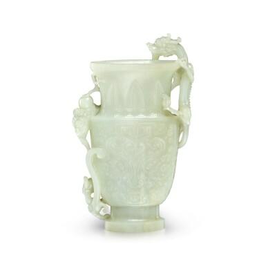View 2. Thumbnail of Lot 28. An archaistic pale celadon jade 'dragon' vase, Qing dynasty, 19th century   清十九世紀 青白玉雕雙龍戲珠仿古饕餮紋瓶.