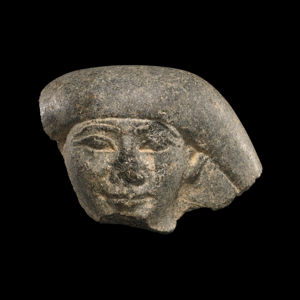 AN EGYPTIAN GRANITE HEAD OF A MAN, LATE PERIOD, EARLY 26TH DYNASTY, CIRCA 664-600 B.C