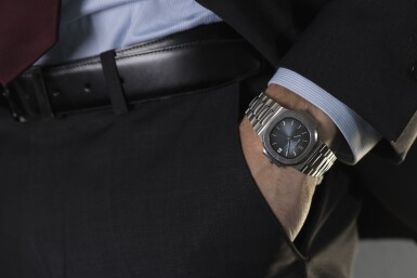 View 4. Thumbnail of Lot 3. PATEK PHILIPPE   NAUTILUS, REF 3800/1A STAINLESS STEEL WRISTWATCH WITH DATE AND BRACELET MADE IN 2003.