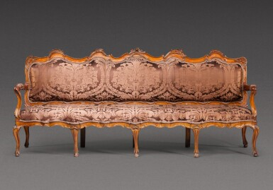 View 1. Thumbnail of Lot 177. A North Italian carved walnut sofa, probably Parma, mid-18th century.