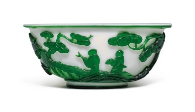 View 1. Thumbnail of Lot 1020. A GREEN OVERLAY WHITE GLASS 'FIGURAL' BOWL, QING DYNASTY, 19TH CENTURY.