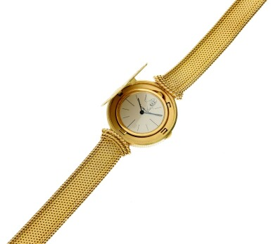 View 9. Thumbnail of Lot 66. A yellow gold coin bracelet watch, Circa 1970.