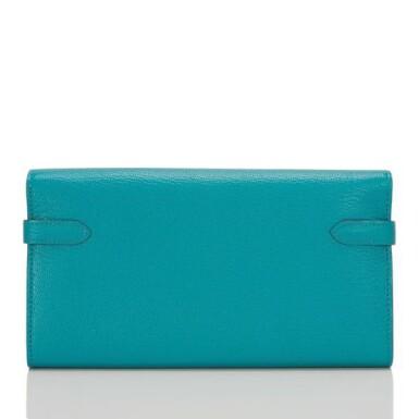 View 3. Thumbnail of Lot 23. Hermès Blue Paon Chevre Leather Kelly Longue Wallet.