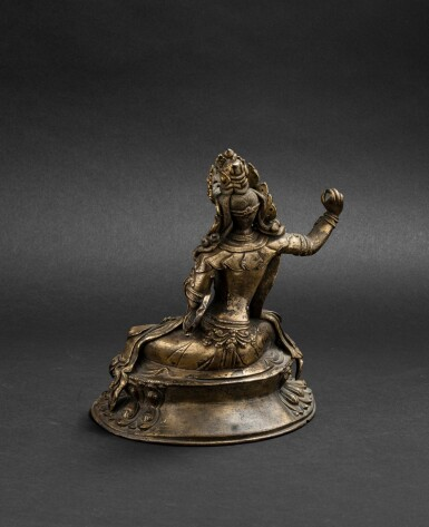 View 3. Thumbnail of Lot 60. Figure de Manjusri en bronze doré Dynastie Qing, XVIIIE siècle | 清十八世紀 鎏金銅文殊菩薩坐像 | A gilt-bronze figure of Manjusri, Qing Dynasty, 18th century.