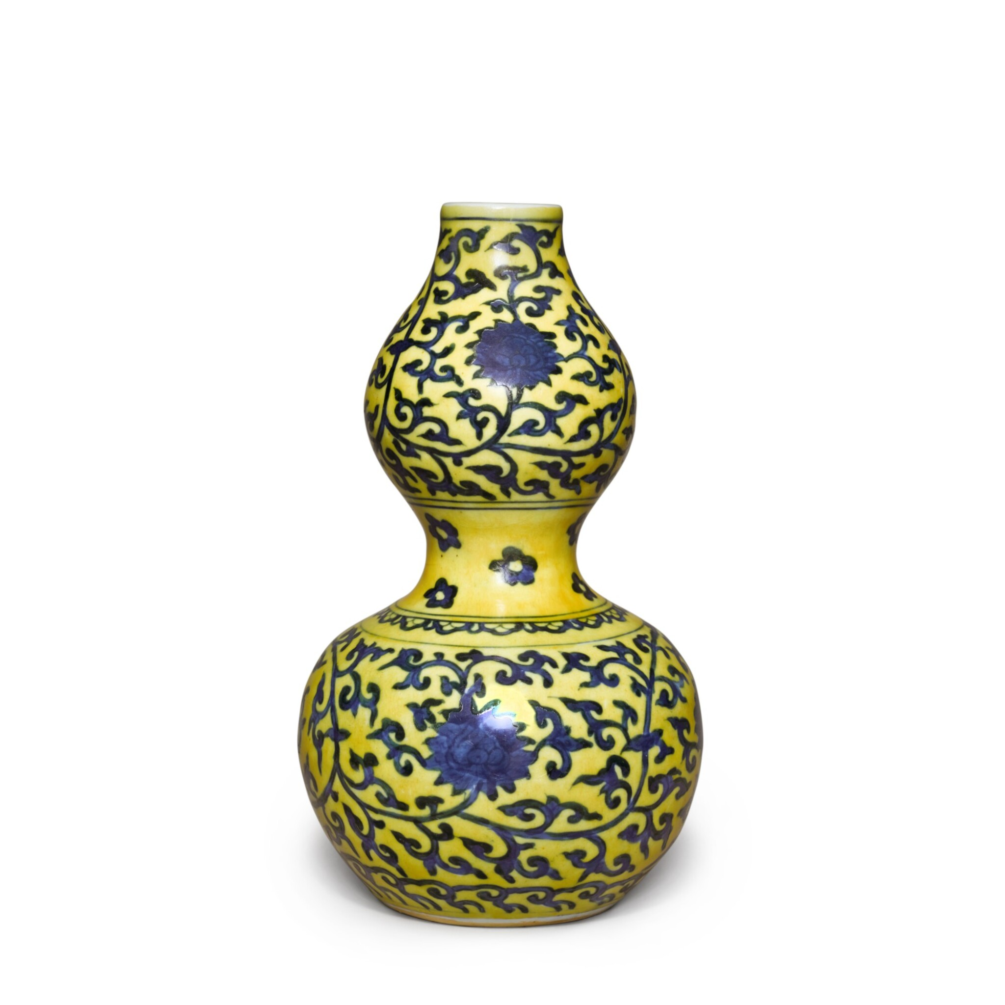 View full screen - View 1 of Lot 83. A yellow-ground underglaze-blue 'double-gourd' vase, Mark and period of Jiajing | 明嘉靖 黃地青花纏枝蓮紋葫蘆瓶 《大明嘉靖年製》款.