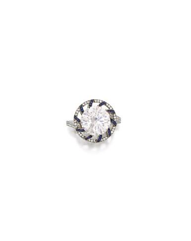 View 1. Thumbnail of Lot 1656. Sotheby's Diamonds by Joseph Ramsay   'Skeleton Saxony' Diamond, Sapphire and Grossular Garnet Ring   「蘇富比鑽石」Joseph Ramsay設計  「薩克森」5.20克拉 圓形 D色 內部無瑕 鑽石 配 藍寶石 及 石榴石 戒指.