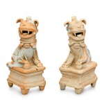 A PAIR OF QINGBAI FIGURES OF BUDDHIST LIONS YUAN DYNASTY | 元 青白釉坐獅一對