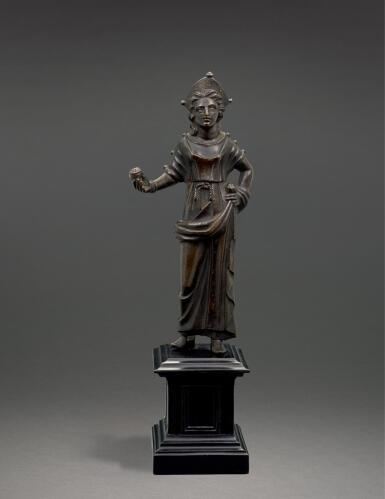 View 1. Thumbnail of Lot 205. AN ETRUSCAN BRONZE FIGURE OF A GODDESS, CIRCA 2ND CENTURY B.C..