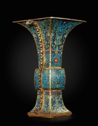 View 4. Thumbnail of Lot 178. A large gilt-bronze and cloisonné enamel ceremonial vase, fanggu 17th century | 十七世紀 掐絲琺瑯獸面紋出戟方觚.