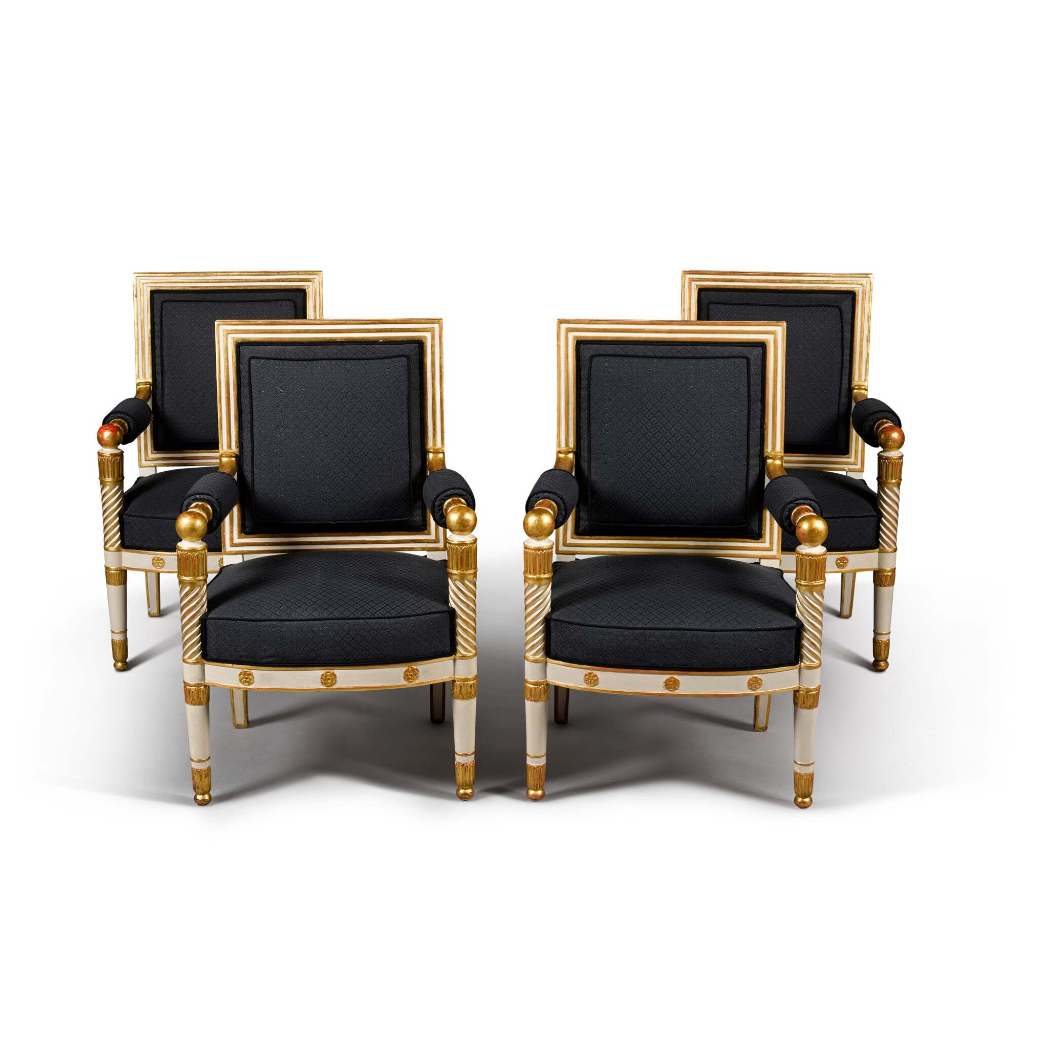 View full screen - View 1 of Lot 12. A set of four Empire white painted and parcel gilt fauteuils, by Jacob, early 19th century.
