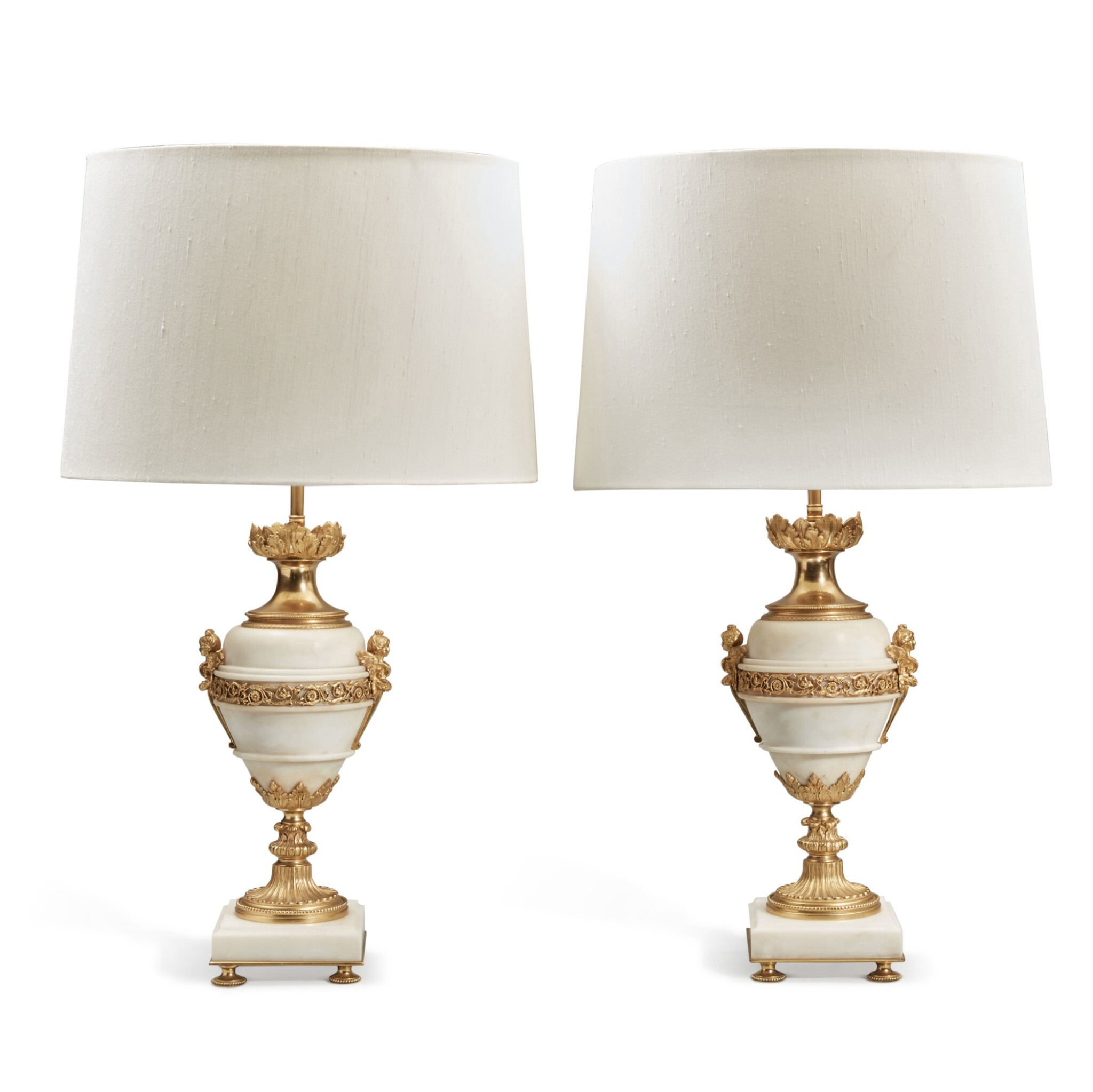 View full screen - View 1 of Lot 128. A Pair of Gilt Bronze and Gilt Metal-Mounted White Marble Lamps.